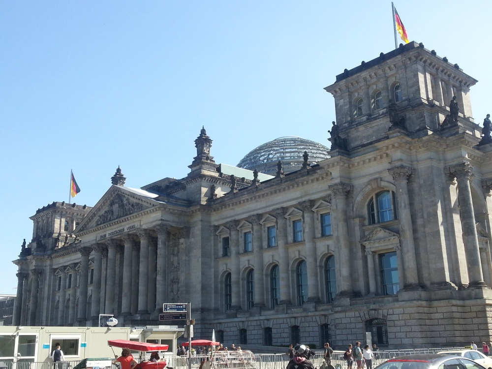 The Reichstag, Germany's parliament. They replaced the destroyed dome with a glass one that with an advanced booking you can walk up and look down into the parliament chambers - symbolising the importance of transparency.
