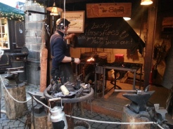 Just your local friendly blacksmith at a the Old Town market