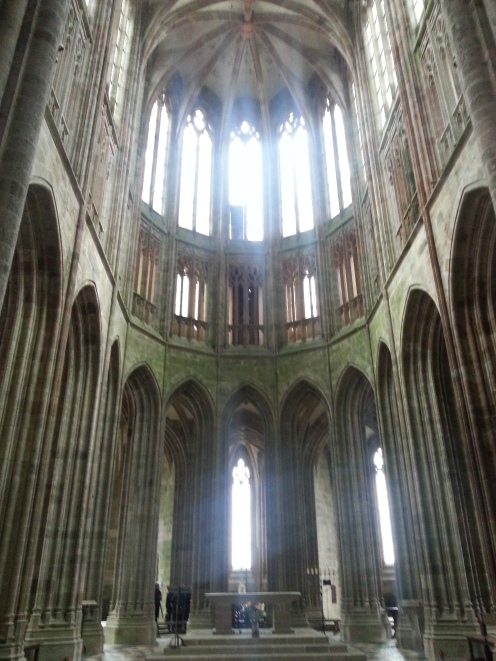 The area above the alter turns gothic, standing out from the rest of the abbey