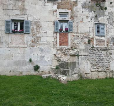 Homes are built into the former walls of the palace, Split